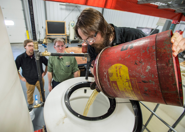 Auto tech faculty, students create waste motor oil-based fuel program