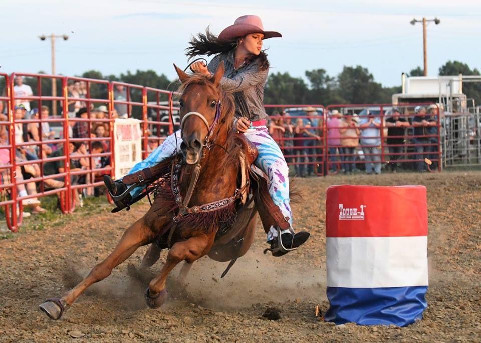 Kaitlin racing around a barrel.