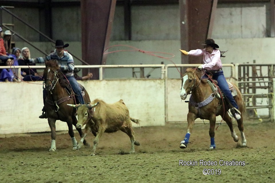 Kaitlin team roping with Dion.