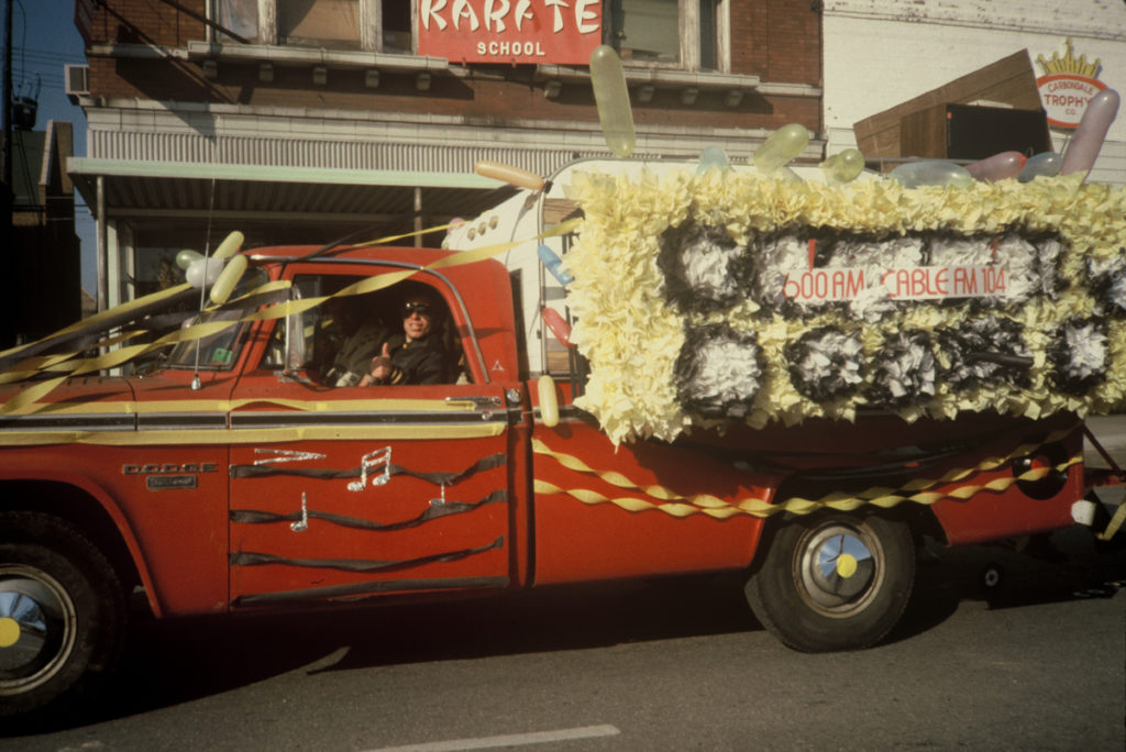 Picture of  Jim Hagarty and his 1966 Dodge pickup truck and float during the 1982 Homecoming.