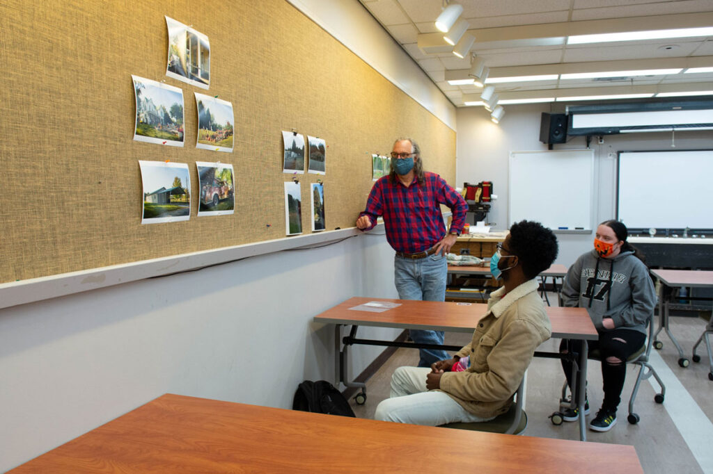 Kevin Barrett, a junior at SIU Carbondale from Zionsville, Indiana, discusses photos he shot earlier this semester of the southern Illinois community of Villa Ridge with photography professor Daniel Overturf. Barrett is one of 10 students taking the biennial Small-Town Documentary class.