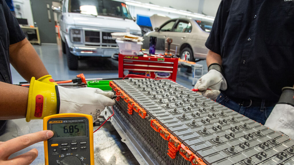 This high-voltage battery-pack, removed from the 2012 Toyota Camry hybrid, is being tested for battery module voltage consistencies.